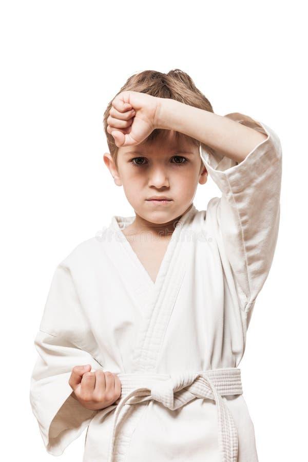 男孩空手道和服培训 免版税库存图片