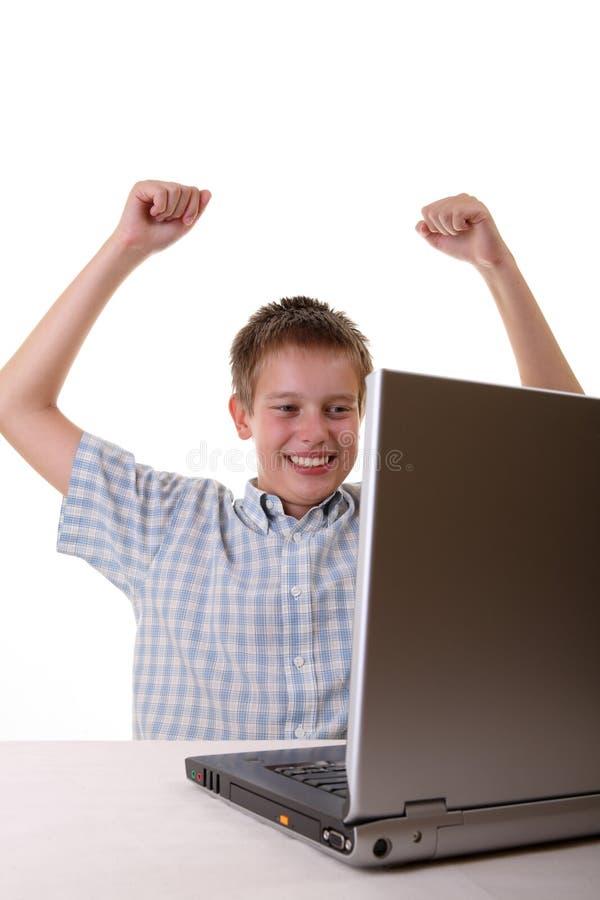 男孩笔记本消费时间年轻人 库存照片