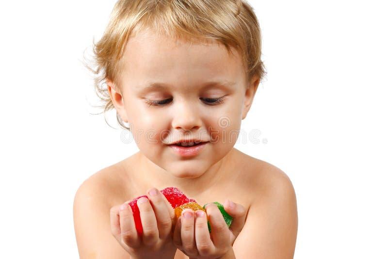 男孩糖果色的果冻一点 库存照片