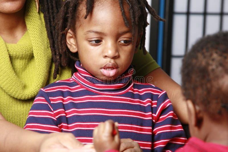 男孩系列他小的中间 图库摄影