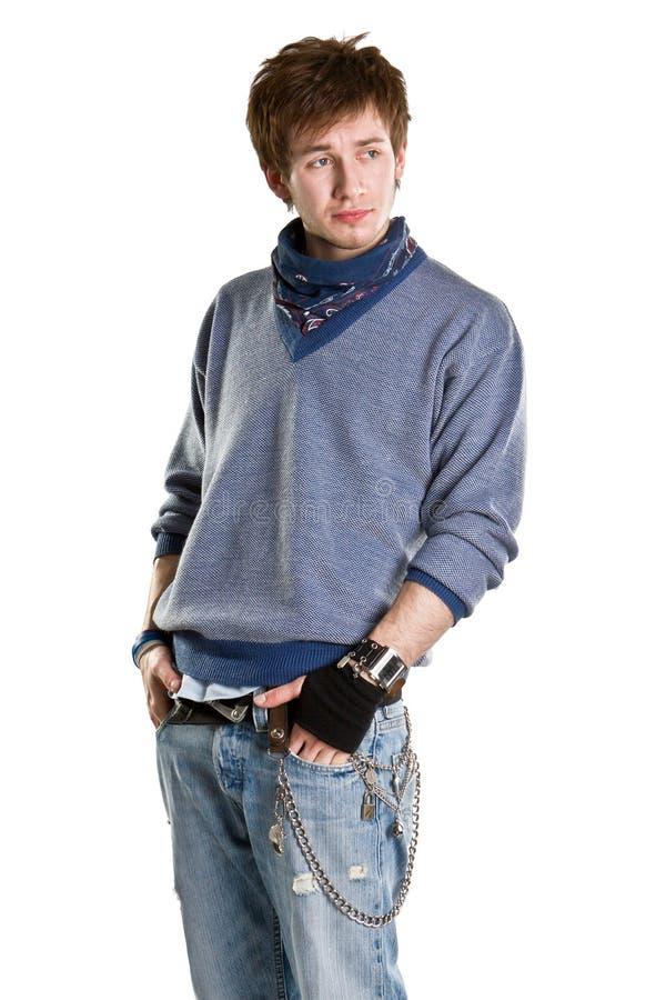 男孩给青年时期穿衣 库存图片