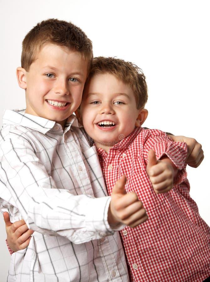 男孩翻阅二年轻人 库存图片