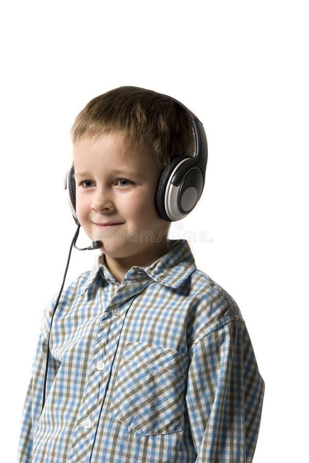 男孩耳朵电话 图库摄影