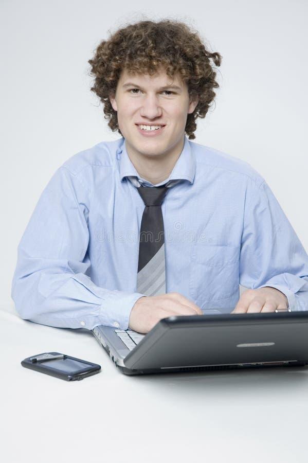 男孩膝上型计算机白色 免版税图库摄影