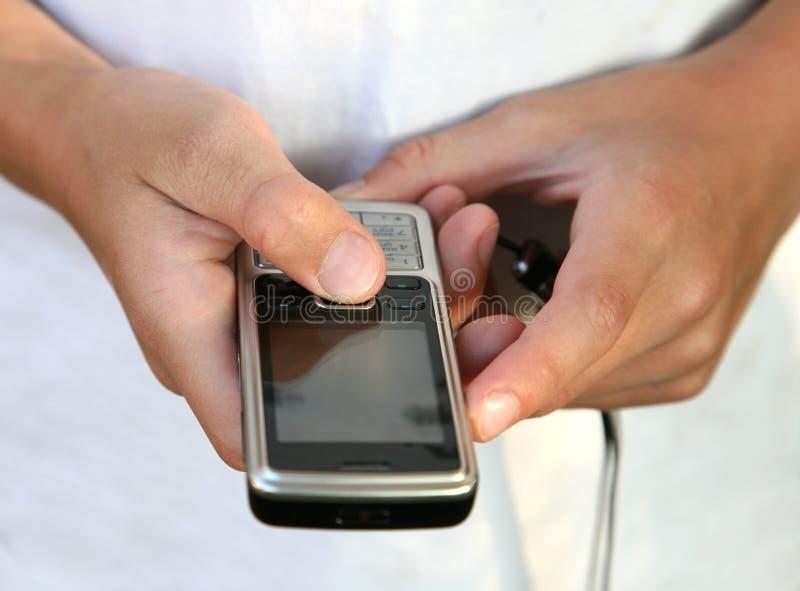 男孩藏品电话 库存图片