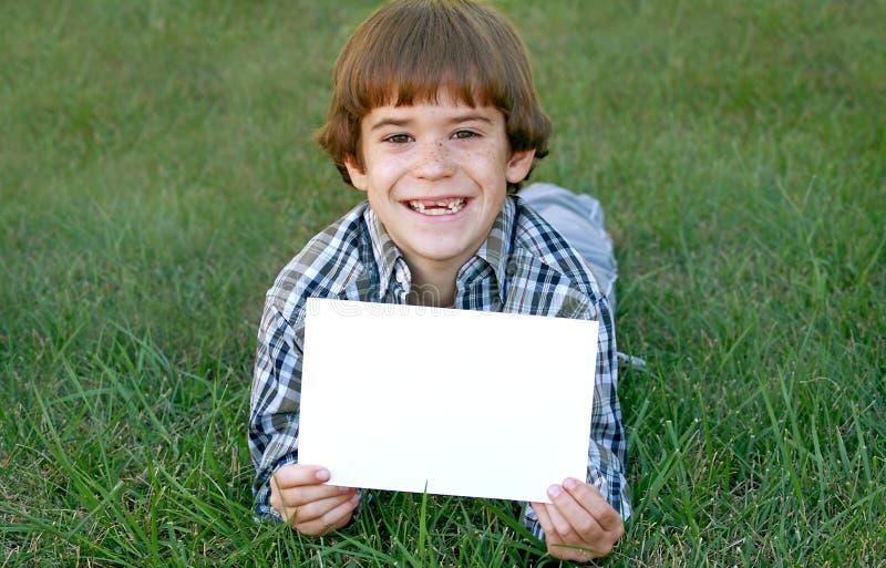 男孩藏品符号 免版税图库摄影