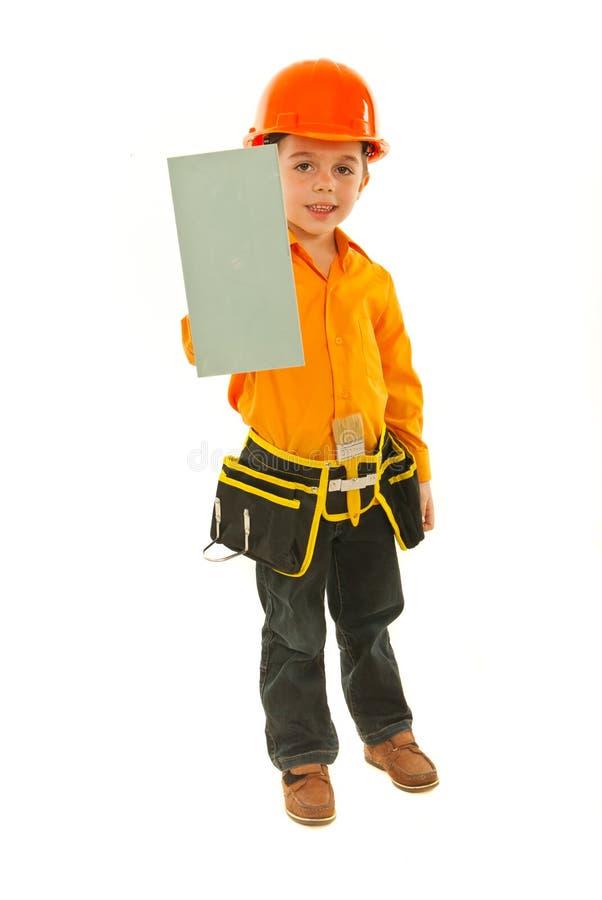 男孩被刻凹痕的建造者藏品 免版税库存照片