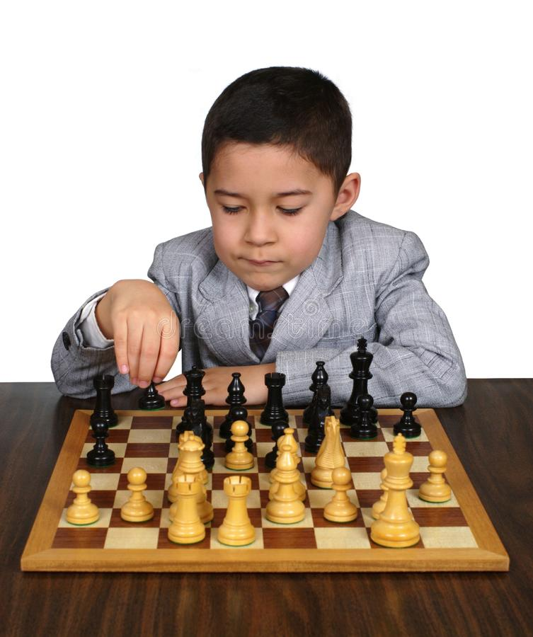 男孩象棋移动认为 库存图片
