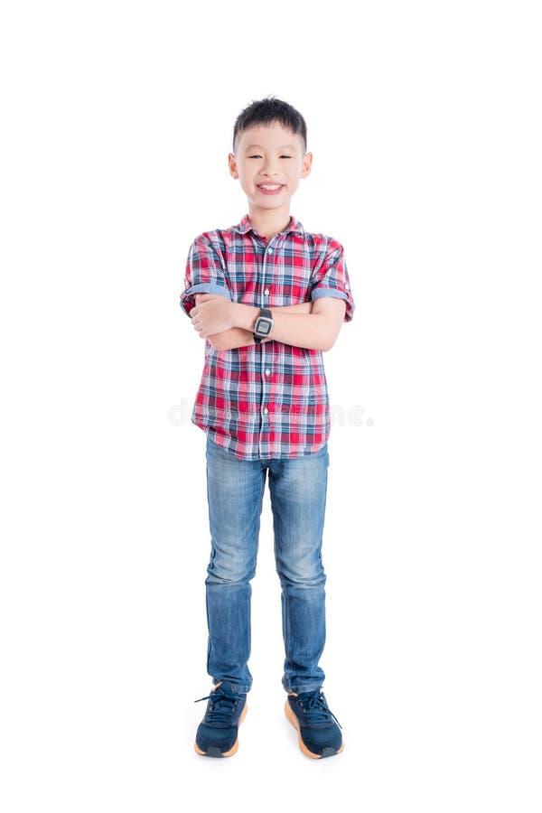 男孩身分和微笑被隔绝在白色背景 免版税库存照片