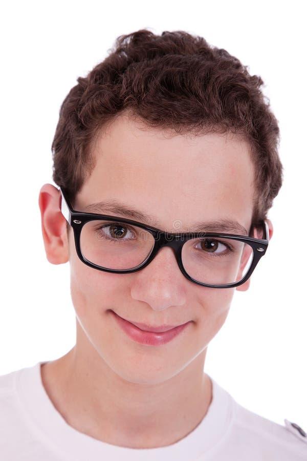 男孩逗人喜爱玻璃微笑 免版税库存照片
