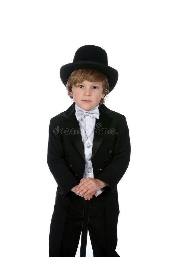 男孩逗人喜爱的帽子顶层无尾礼服年&# 库存图片