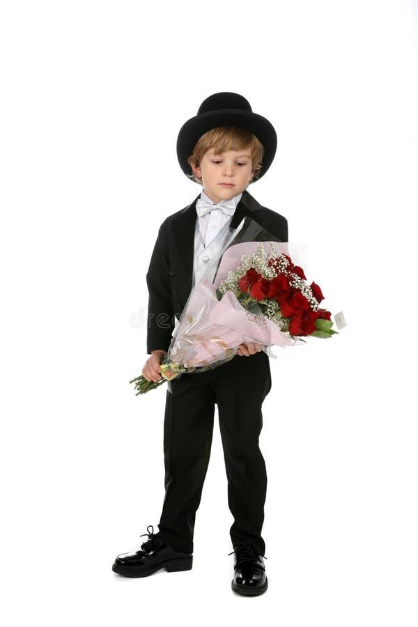 男孩逗人喜爱的帽子顶层无尾礼服 免版税库存照片