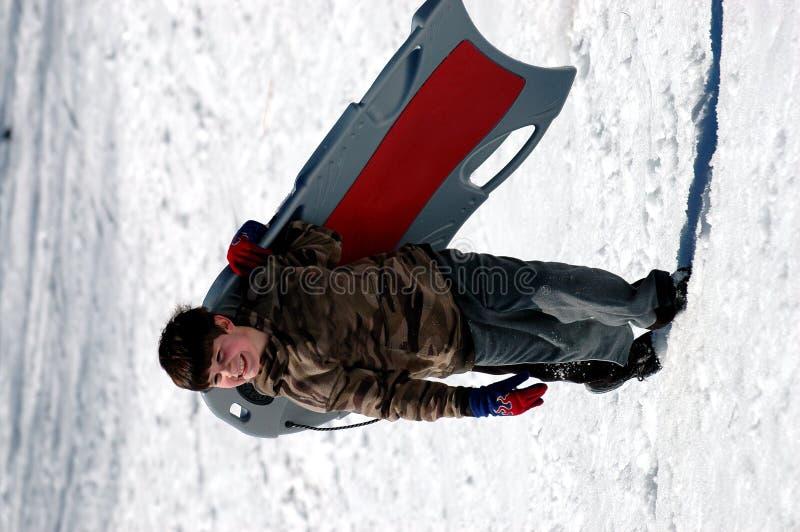 男孩雪撬 库存图片