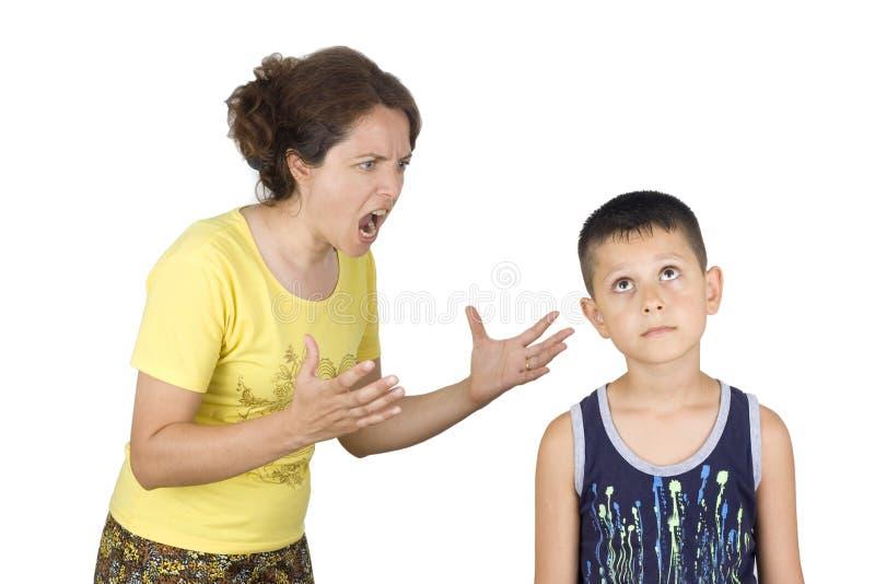 男孩面对他的母亲 免版税图库摄影