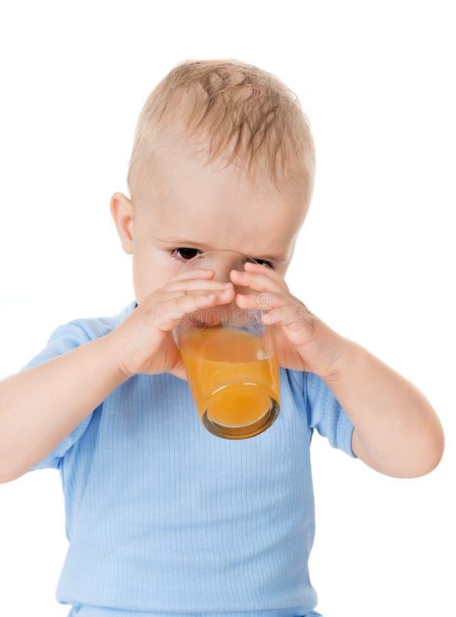 男孩饮料汁液 免版税图库摄影