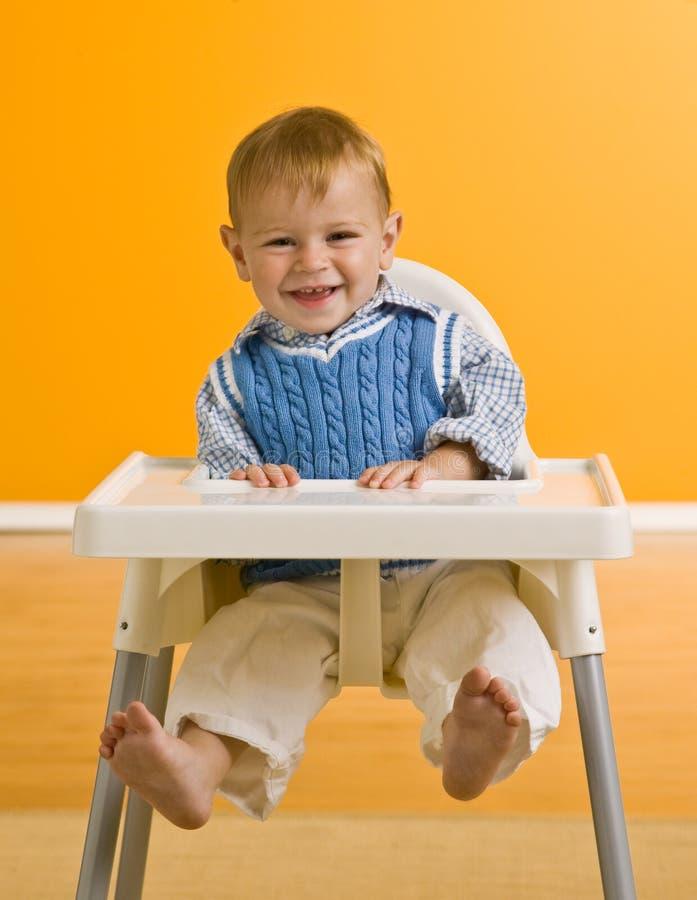 男孩高脚椅子年轻人 免版税库存图片