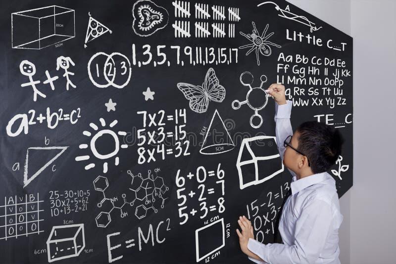 男小学生文字数学惯例 库存图片