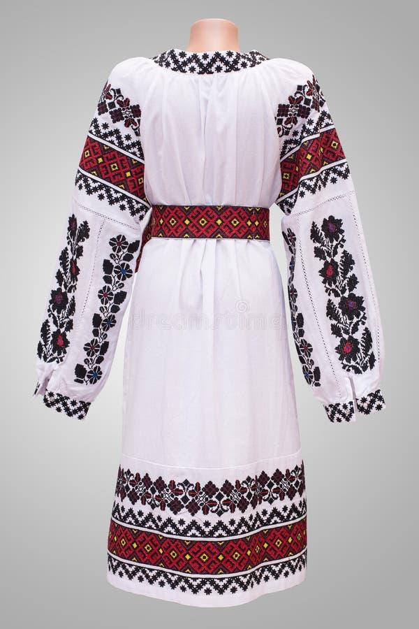 男式衬衫女性全国民间传说,在灰色白色背景的一套民间服装乌克兰, 免版税库存图片