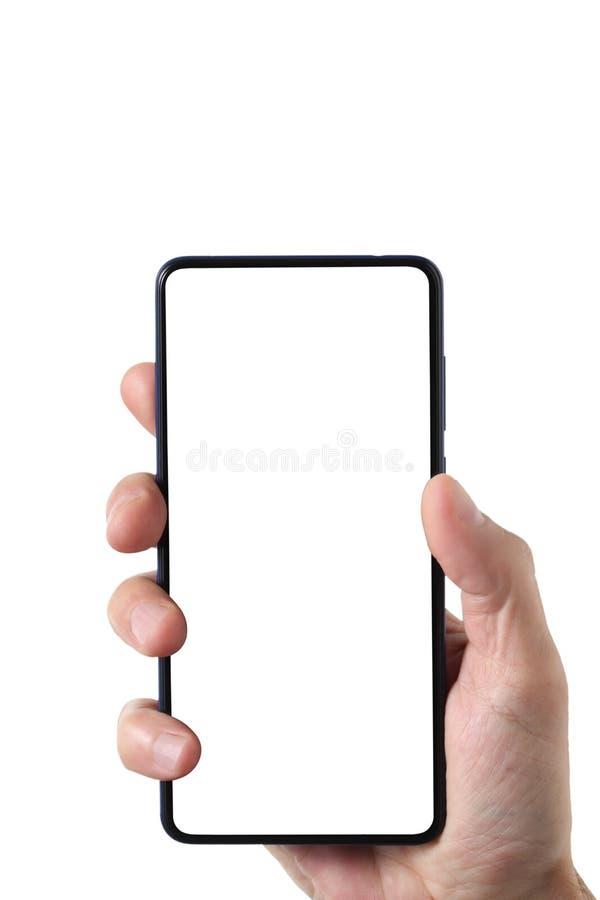 男性人藏品和显示在与裁减路线的白色与警察的背景在手附近和显示隔绝的空白的智能手机 免版税库存照片