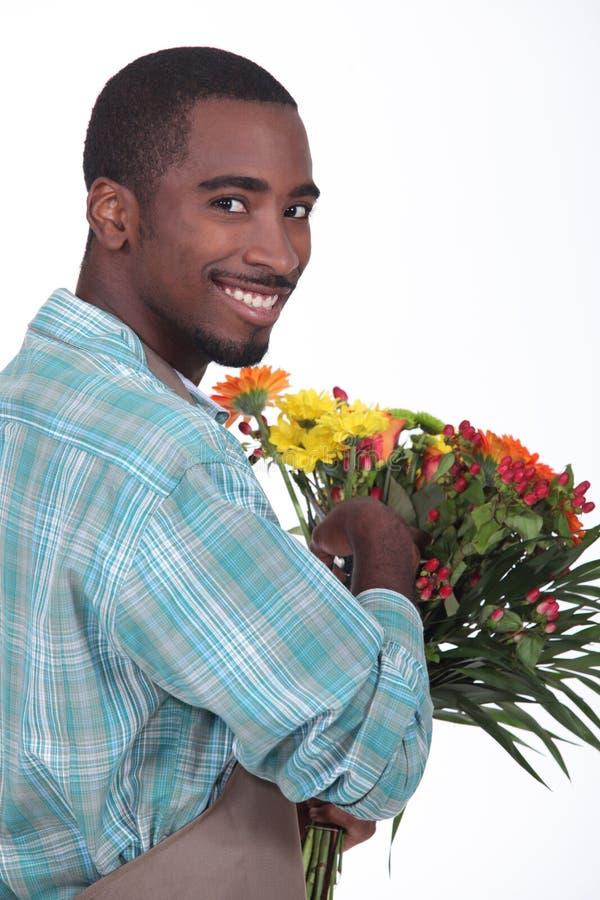 男性卖花人 免版税库存照片