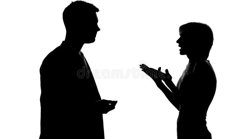 男性和女性争论和争吵,联系和冲突剪影  图库摄影