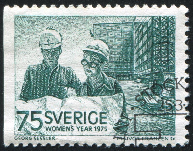 男性和女性建筑师 免版税库存图片