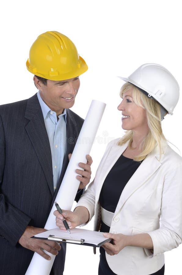 男性和女性建筑师会议 库存照片