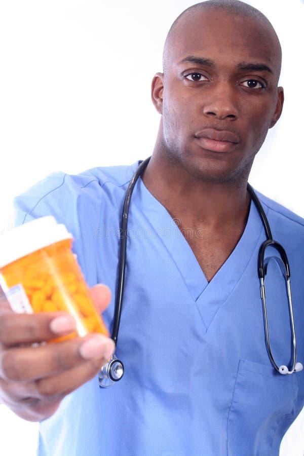 男性护士药片 免版税库存照片
