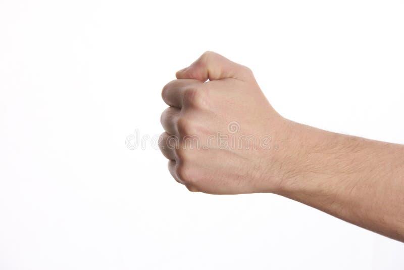 男性握紧了拳头,隔绝在白色背景 免版税图库摄影