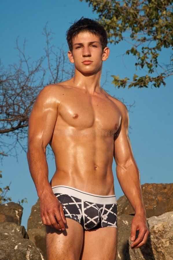 男性模型岩石 库存图片