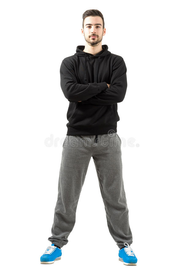 年轻男性用在运动服的被折叠的手 图库摄影