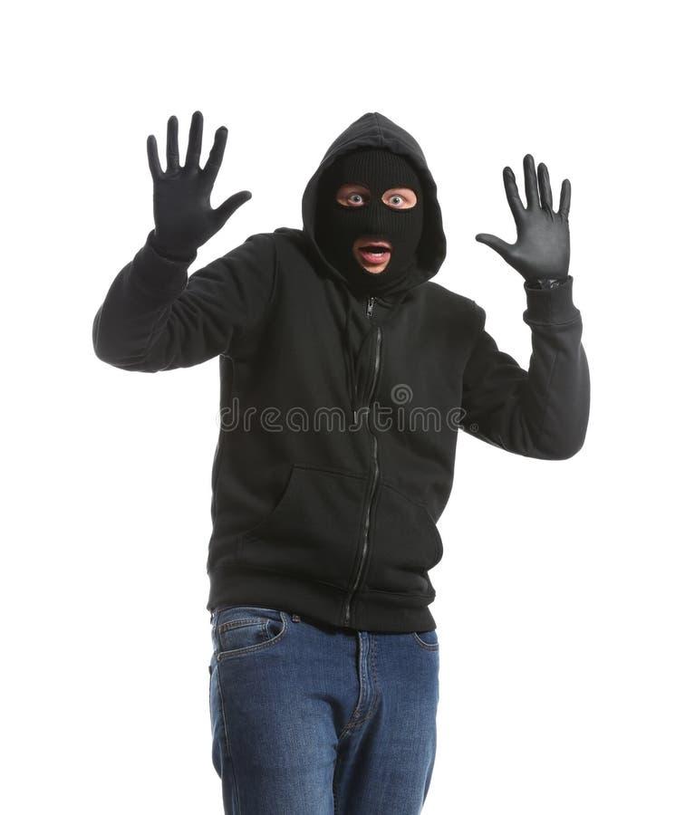 男性窃贼用在白色背景的被举的手 图库摄影