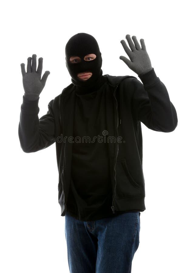 男性窃贼用在白色背景的被举的手 免版税库存照片