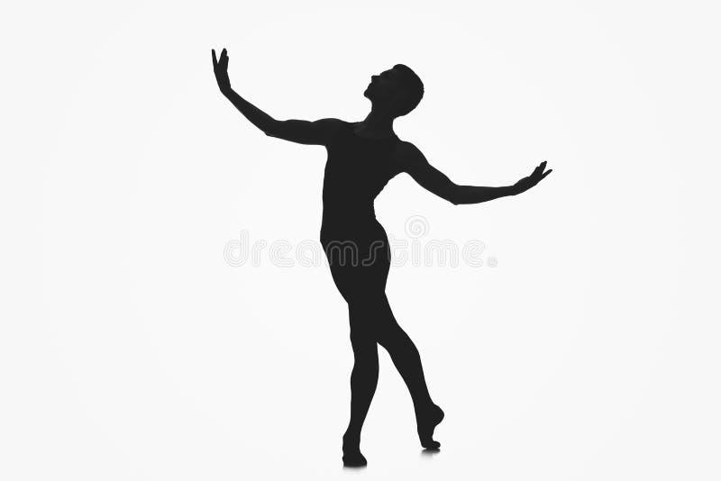 男性跳芭蕾舞者剪影 免版税库存图片