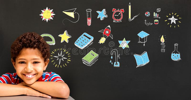 男生和教育图画在黑板学校的 库存图片