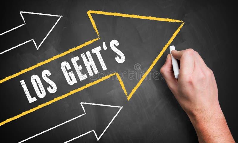 画几个向上指向的箭头和词组的手'让我们走'用德语 免版税库存图片