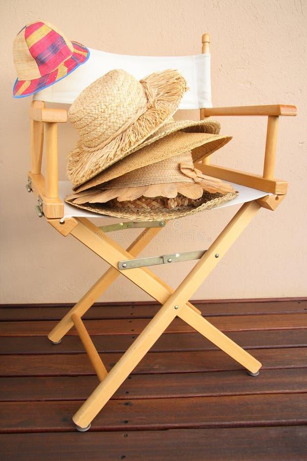画布椅子草帽子 库存照片