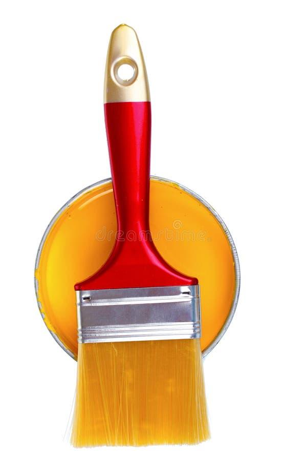 画笔可能开张油漆黄色 库存照片