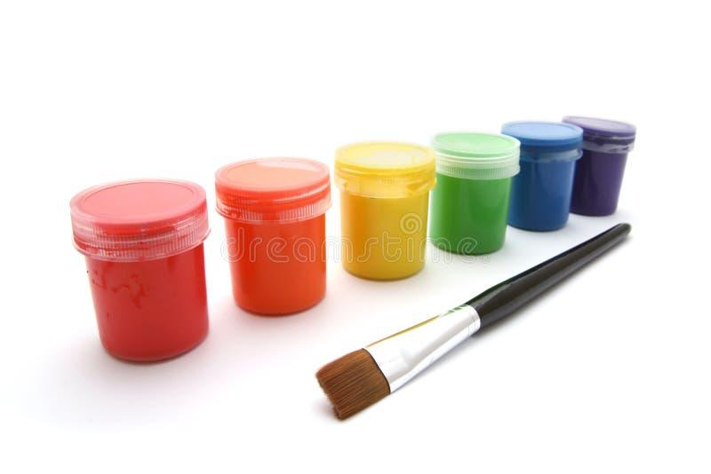 画笔装树胶水彩画颜料油漆于罐中 免版税库存图片