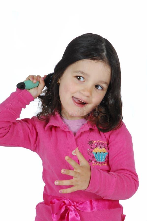画笔逗人喜爱的女孩头发一点 免版税库存图片