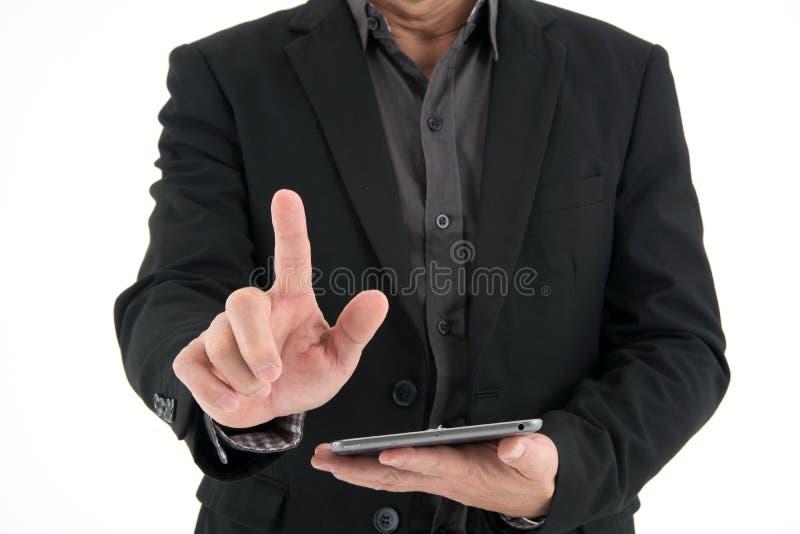 画象每商人展示手指点和拿着在白色背景的移动设备 库存照片