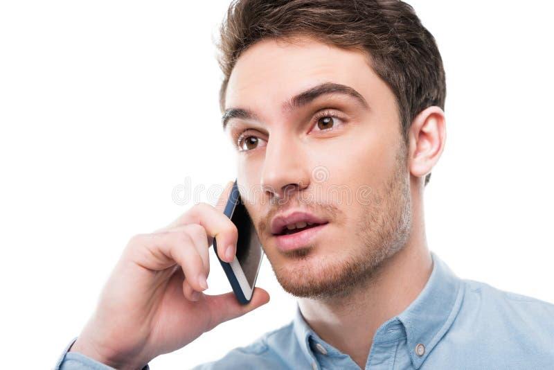 画象英俊谈话在智能手机 免版税图库摄影