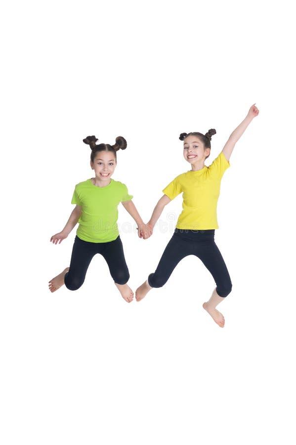 画象逗人喜爱小女孩跳跃 图库摄影