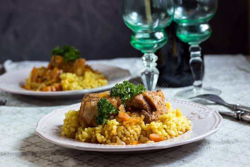 番红花意大利煨饭和猪肉 图库摄影