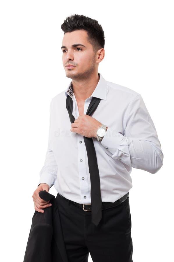 疏松他的黑领带的商人 免版税库存照片