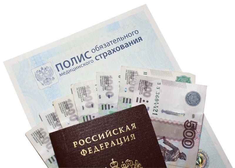 医疗保险政策、护照和金钱 免版税图库摄影