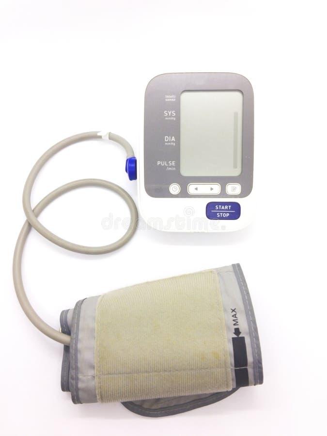 疗程概念,灰色血压计在白色b被隔绝 库存图片