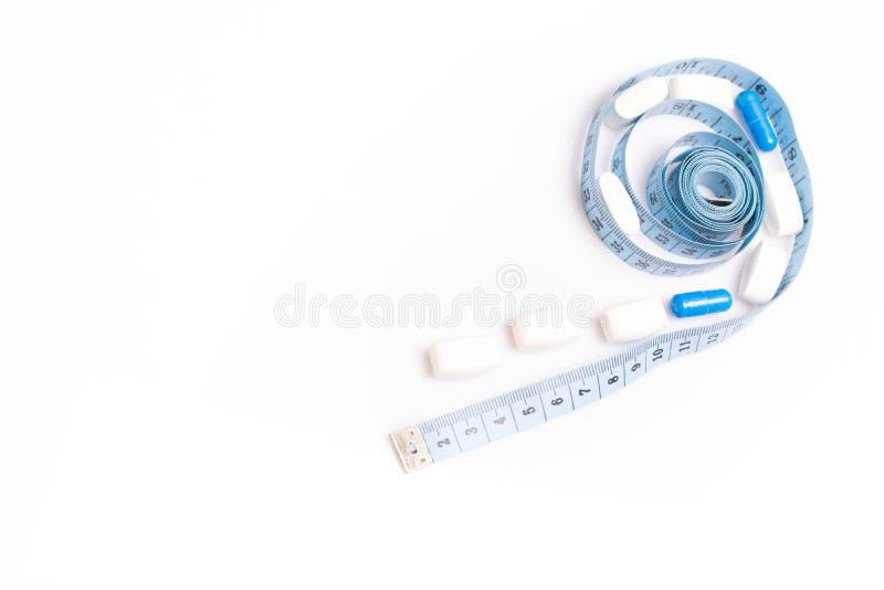 医疗药片和厘米,减重或增量阴茎大小的 免版税库存照片
