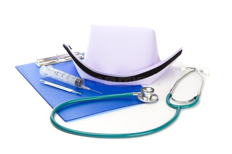 医疗设备和护士帽子 免版税库存图片