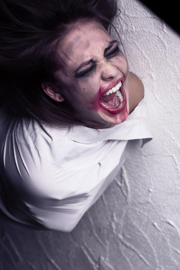 疯狂的叫喊的妇女 库存照片